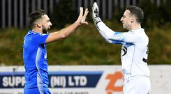 Dungannon players celebrate after winning on penalties.