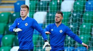 In safe hands: Bailey Peacock-Farrell (left) and Trevor Carson have both been excellent when called upon by manager Michael O'Neill