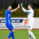 Swifts soar: Dungannon captain Chris Hegarty celebrates with keeper Niall Morgan after seeing off Cliftonville on penalties