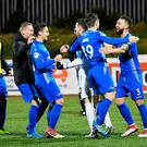 Spot on: Dungannon players celebrate after winning on penalties against Cliftonville on Tuesday evening