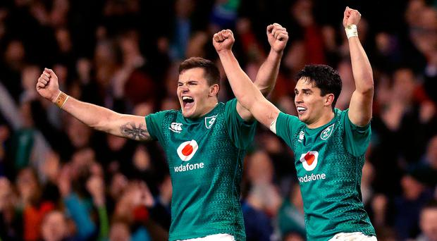 We've done it: Ireland's Jacob Stockdale and Joey Carbery celebrate at the final whistle after defeating the All Blacks