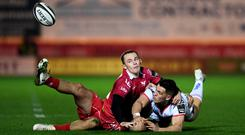 James Hume of Ulster is tackled by Kieron Fonotia and Ioan Nicholas of Scarlets. Pic ©INPHO/Alex Davidson