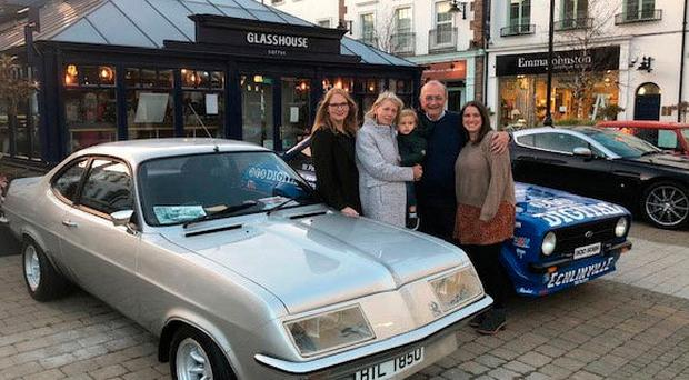 Revving up: Plum Tyndall with members of his family, (from left) daughter Cathy, wife Lynn with grandson Rory, and daughter-inlaw Dee, at the Lisburn launch of his book. The car is his Irish Championship-winning Vauxhall Firenza from 1976