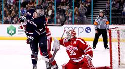 Kept out: University of Connecticut's Kale Howarth is thwarted by BU netminder Jake Oettinger