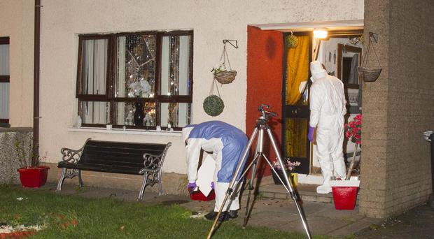 The scene at Rathmore Road, Newry on Saturday evening as forensics officers from the PSNI collect evidence. Credit: Newraypics.com