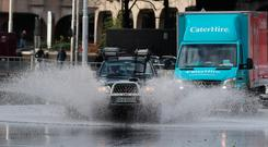 Cars navigate a flooded street in Dublin as the tail end of Storm Diana crosses the East Coast of Ireland. PRESS ASSOCIATION Photo. Picture date: Tuesday November 27, 2018. See PA story WEATHER Wind Ireland. Photo credit should read: Niall Carson/PA Wire