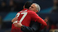 Manchester United's Belgian midfielder Marouane Fellaini celebrates with Jose Mourinho after sending his side through to the knock-out stages.