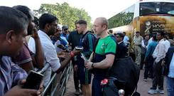 Press gallery: Banbridge's Eugene Magee gives an impromptu press conference on Ireland's arrival in India for start of World Cup