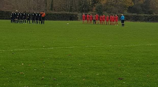 Liffey Wanderers FC posted this picture on Facebook of teams observing a minute's silence in memory of the Ballybrack player who was reported to have died