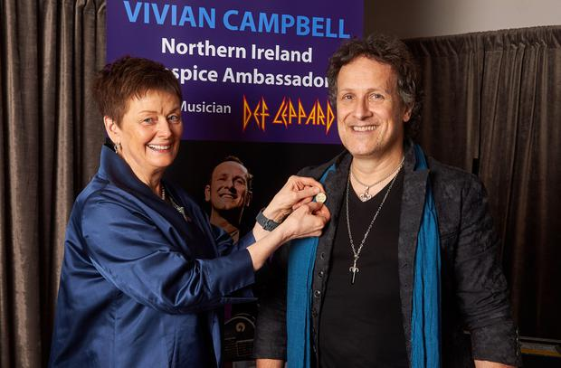 Def Leppard guitarist Vivian Campbell becomes an ambassador for the Northern Ireland Hospice Association with chair of trustees Margaret Butler at The Royal Albert Hall, London. Photo credit: Simon Jacobs