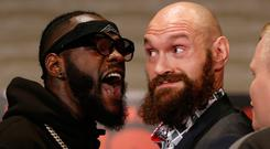 Boxers Deontay Wilder, left, and Tyson Fury exchange words at a pre-fight press conference.