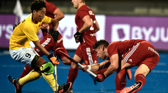 Take that: Ulsterman Mark Gleghorne fires home his penalty corner for England against China in the World Cup finals in India