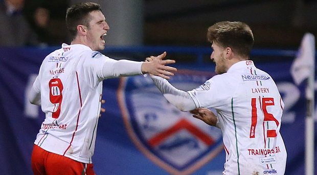 What a feeling: Newry's Mark McCabe (left) celebrates with Stefan Lavery after scoring the winner last night