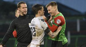 Referee Andris Treimanis watches on as a brawl erupts.