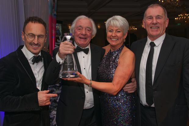 Hector is pictured accepting his award from committee members (from left) Jeremy McWilliams, Pamela Ballantine and Drew Wylie