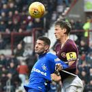 Aerial duel: Christophe Berra and Kyle Lafferty on Sunday