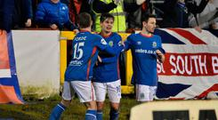 Winner: Jordan Stewart (centre) saluted after his late Linfield winner at Portadown last night