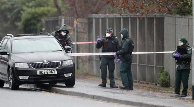 Police at the scene of the shooting in Glen Road, west Belfast (Niall Carson/PA)