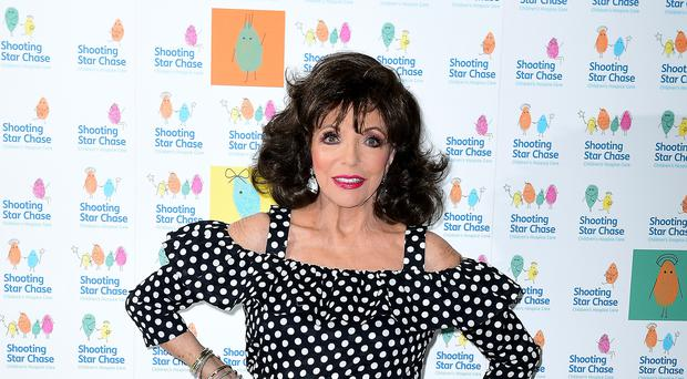 """Dame Joan Collins has said she had a """"transgender moment"""" as a teenager (Ian West/PA)"""