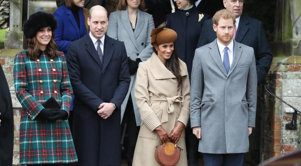 Family gathering: the Duke and Duchess of Cambridge alongside the Duke and Duchess of Sussex at the Christmas Day church service last year