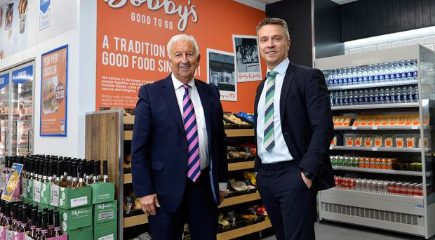 Andrew Lynas, managing director of Lynas Foodservice, and group chairman Norman Lynas in the new Lynas Food outlet in Belfast