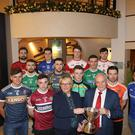 Up for the Cup: Angela Callan, Bank of Ireland, and Oliver Galligan, vice president Ulster GAA, with representatives of the 12 McKenna Cup teams at last night's launch