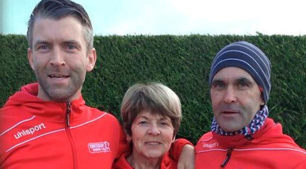Happy family: Joe, Celine and Connor McCarroll at a race