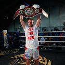 Jubilant: Conrad Cummings shows off his WBO prize last night
