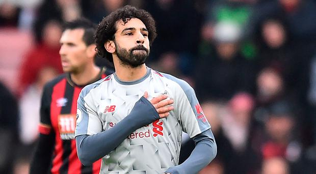 Mohamed Salah celebrates netting at Bournemouth.