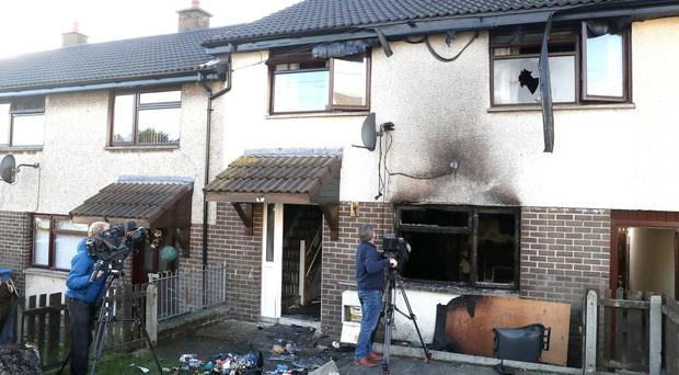 Press Eye - Larne Arson Attack - 9th December 2018 Co Antrim residents were evacuated from their homes last night following an arson attack. A wheelie bin was set alight inside a property in the Fairway area of Larne at around 9.15pm. Considerable damage was caused by the blaze, which police have branded a