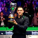 Ronnie O'Sullivan celebrates winning the Betway UK Championship, his 19th major title.