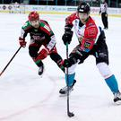 Man on: Belfast Giants ace Curtis Leonard is pursued by Charles Linglet of the Cardiff Devils