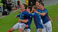 Magic man: Linfield players celebrate with Jordan Stewart after his wonder goal against Crusaders