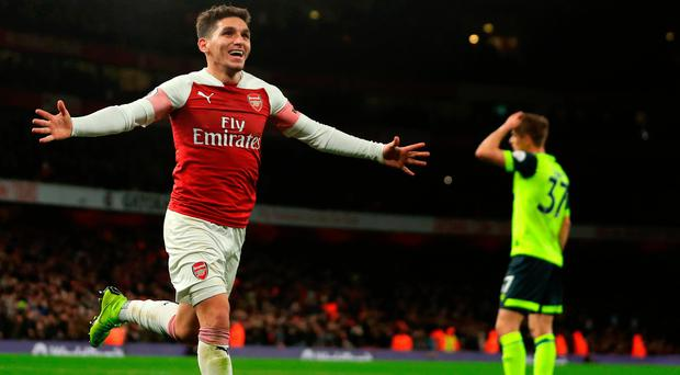 Decisive say Arsenal's Uruguayan midfielder Lucas Torreira runs off after hitting the winner against Huddersfield