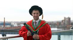 Jonathan Rea collects his Honorary degree from the University of Ulster at Belfast's Waterfront Hall
