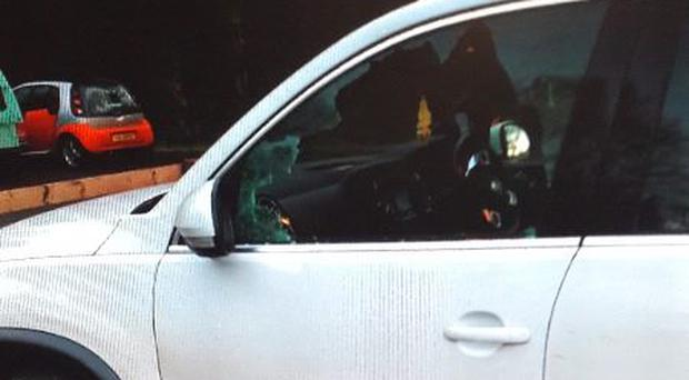 The window of the car was smashed by thieves / Credit: PSNI
