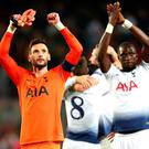 Hugo Lloris and Moussa Sissoko celebrate Champions League progression.