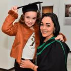 Roisin O'Neill ,with her daughter Casidhe, says she did not let her illness get her down as she graduates with a degree in business and accounting from Ulster University