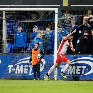 Dangerman: Andrew Waterworth turns away in celebration after his extra time winner for Linfield at Stangmore Park