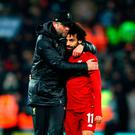 Marching on: Jurgen Klopp embraces goal hero Salah