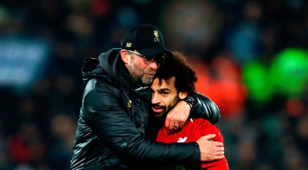 Marching on Jurgen Klopp embraces goal hero Salah