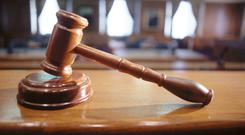 A man was assaulted in his home by intruders armed with a wrench and a mop stick, a court has heard.