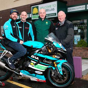 New deal: Alastair Seeley pictured with the EHA Racing Yamaha R6 he will ride in the Supersport races at the North West 200. Also included are Edward Allingham, EHA Racing team boss, David Shirley of JP Corry, Coleraine, the team's lead sponsor for the NW200, and Mervyn Whyte, NW200 Event Director