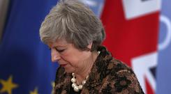 Theresa May speaks during a media conference during an EU summit in Brussels, Friday, Dec. 14, 2018.