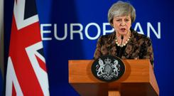 Theresa May speaks during a press conference on December 14, 2018 in Brussels during the second day of a European Summit aimed at discussing the Brexit deal, the long-term budget and the single market.