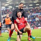 Jacob Stockdale celebrates his try with Tommy O'Toole.