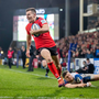 Damage done: Jacob Stockdale runs in for his score