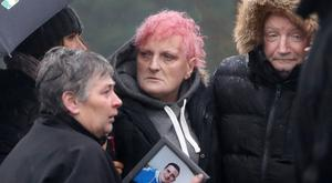 Funeral - Press Eye - Loughinisland - 15th December 2018 Photograph by Declan Roughan Marie Fox (centre) with her family at the funeral of her son Padraig.