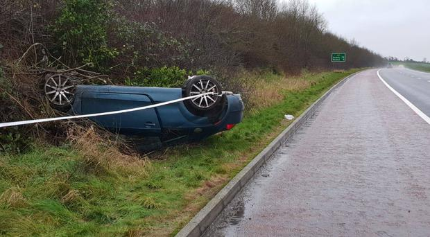 A car ended up on its roof after crashing on the A1. Credit: PSNI.