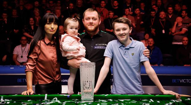 Happy family: Mark Allen, wife Kyla, daughter Harleigh and stepson Robbie with the Scottish Open trophy in Glasgow last night